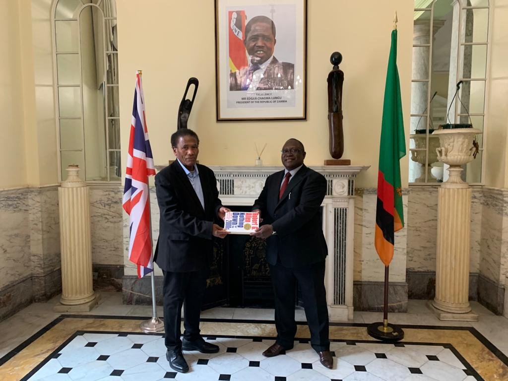 High Commissioner Mihova receiving donated books from Mr. Jospeh Lawrence
